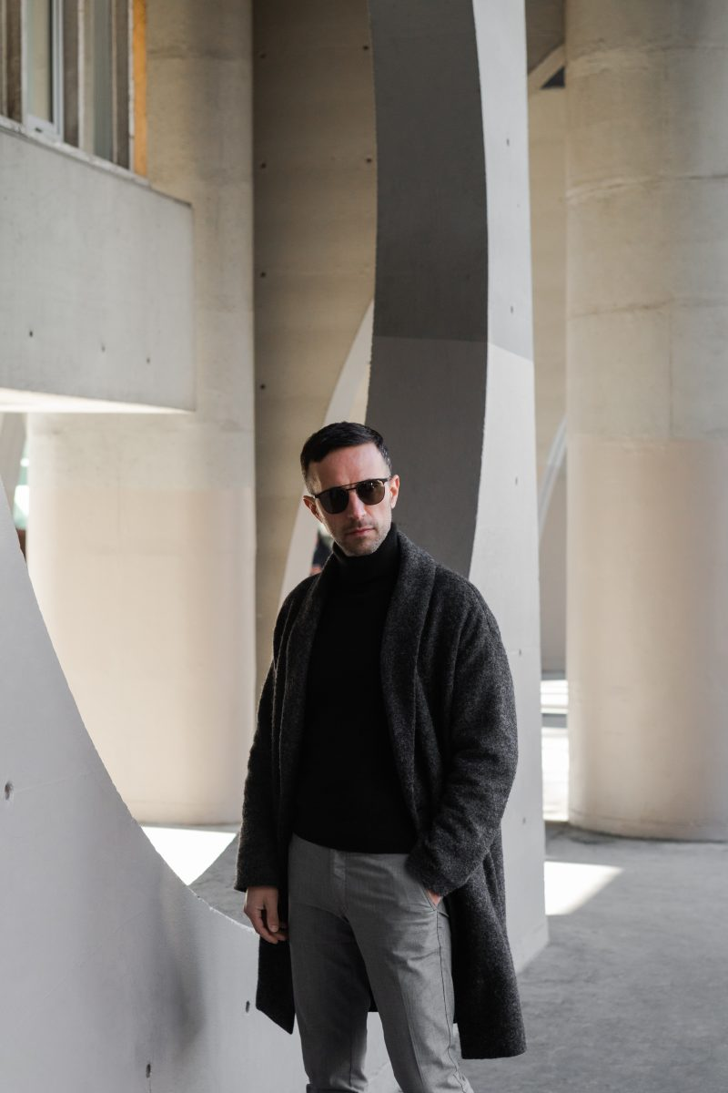 @theparisianman next to brutalist structures
